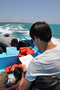 Scantlebury reads up on <em>Sphaerodactylus ariasae</em> as we approach Isla Beata.